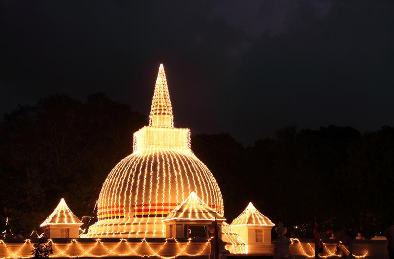 <p>Buddhist temple illuminated at night on full moon day, Kelaniya, srilanka</p>Buddhist temple illuminated at night, Kelaniya Srilanka