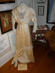 6760   Antique wedding dress on display