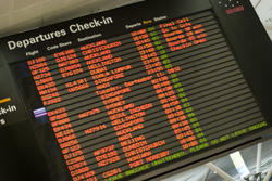 10672   Departures Check in board at an airport