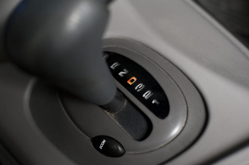 Automatic gearbox in a car with a high angle view of the gear shift in gear icons