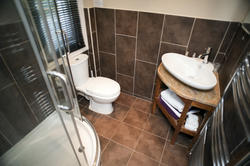 10657   Interior of a bathroom tiled in brown
