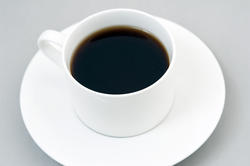 11611   Cup of black coffee on saucer
