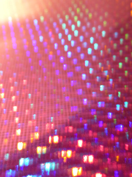 a reflective hologram background featuring vivid spots of colour