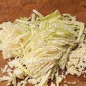 10503   Finely chopped cabbage on a kitchen counter