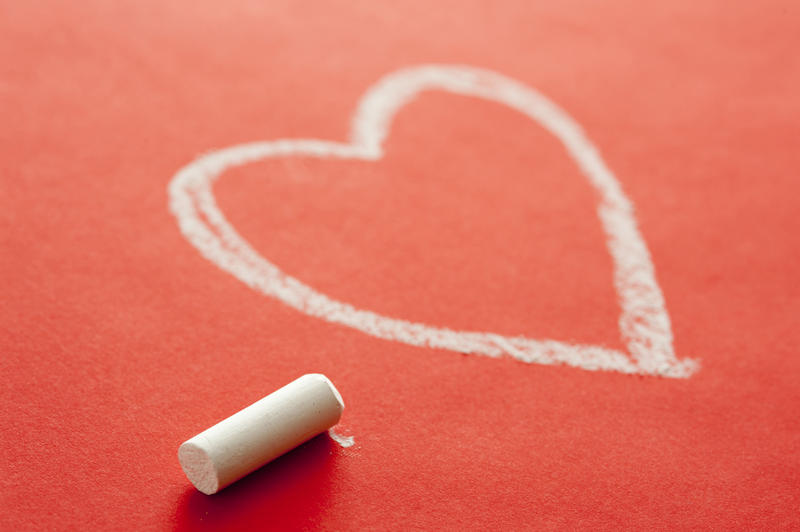 11534   White Chalk Beside Heart Drawn on Red Background