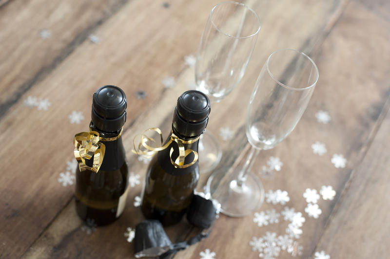 individual bottles of champagne for two people wrapped in gold ribbon