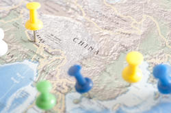 10680   Multi Colored Thumb Tacks Inserted in Map of China