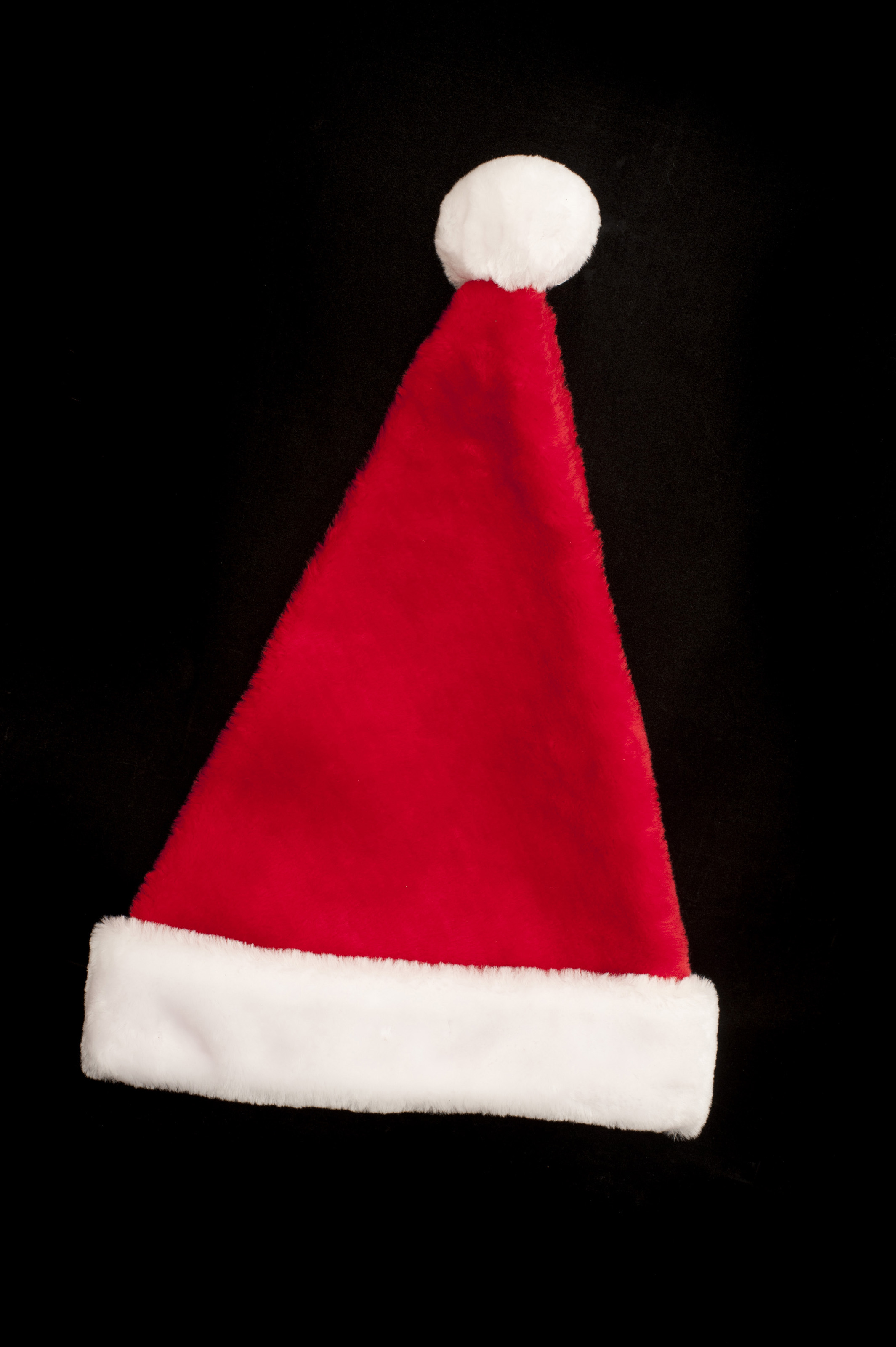 free stock photo 10568 red and white christmas hat on black