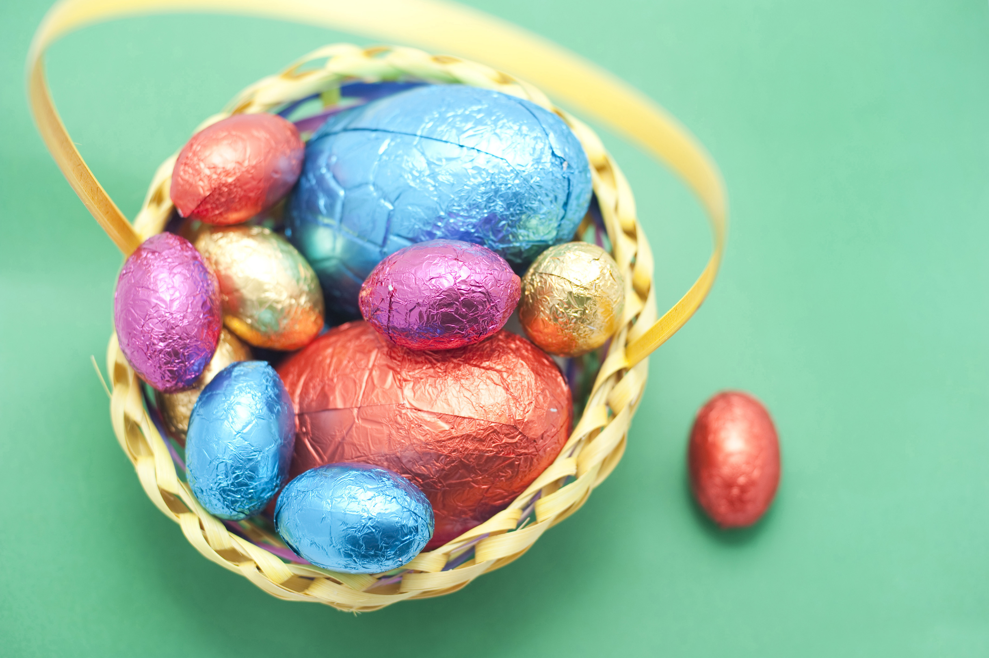 Free stock photo 7885 collected easter eggs in a basket freeimageslive overhead view of chocolate easter eggs in colourful foil wrappings in a basket on a green negle Choice Image