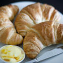 8457   Three golden flaky croissants