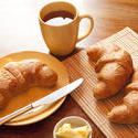 10252   Breakfast with croissants, butter and a cup of tea