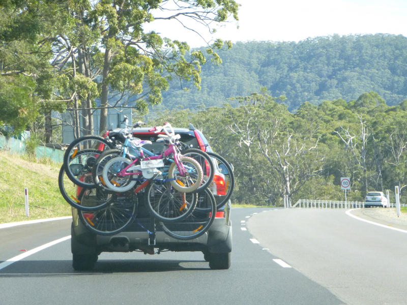 10985   Vehicle driving on a road with a cycle carrier