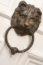10636   Bronze door knocker in the shape of a lions head