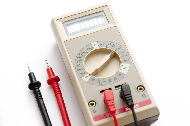Electrical handheld meter with positive and negative cables for checking electrical circuits and wiring to test electornic components