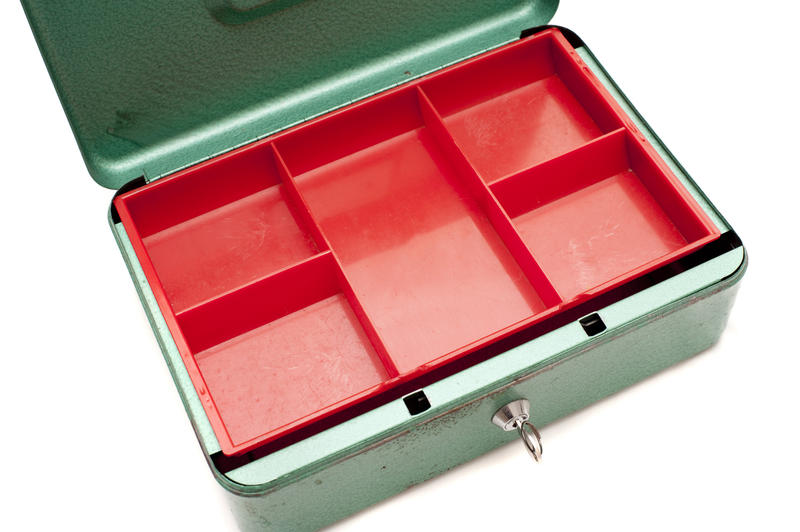 Close up Open Empty Metal Petty Cash Box in Red and Green Color with Key. Isolated on White Background.