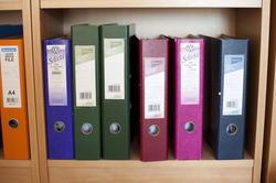 10812   Files on Colored Binders Placed on Cabinet