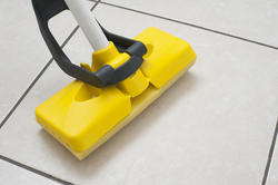 10637   Mopping the tiled floor with a plastic squeegee