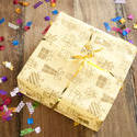 11452   Yellow Birthday Gift on Table with Confetti