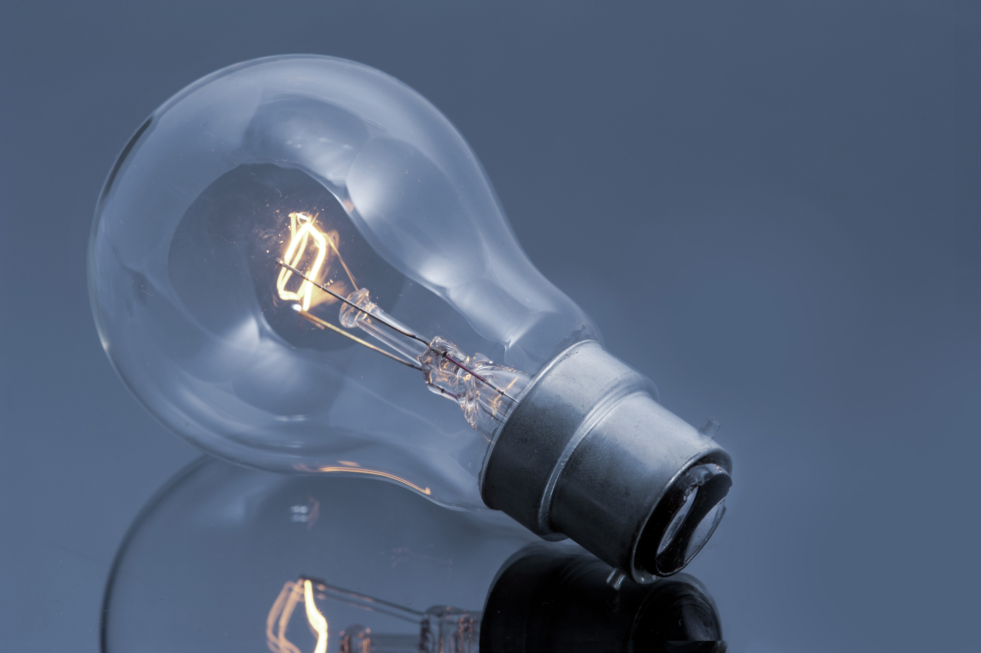 free stock photo 10757 glowing light bulb on glossy gray