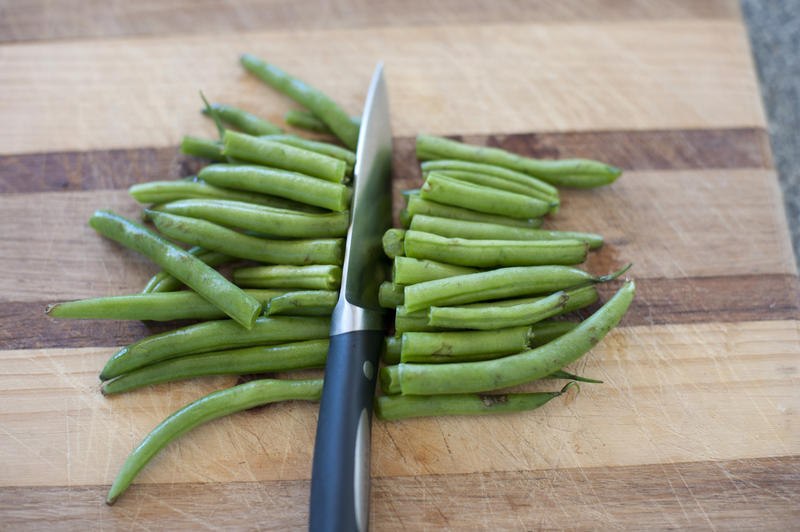 10612   Sliced Fresh Green String Beans on a Wooden Board