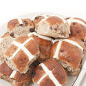 10614   Fresh Hot Cross Buns on a Plate Isolated on White