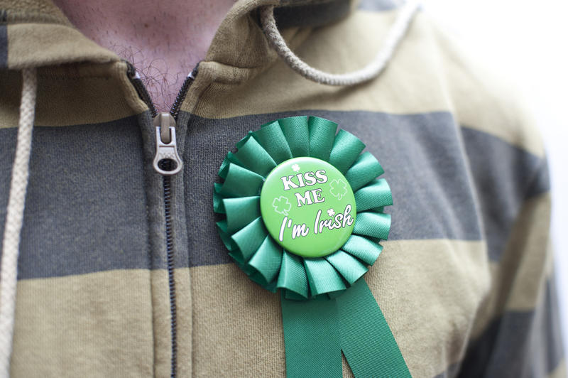 close up on a man wearing a st patricks day kiss me ribbon