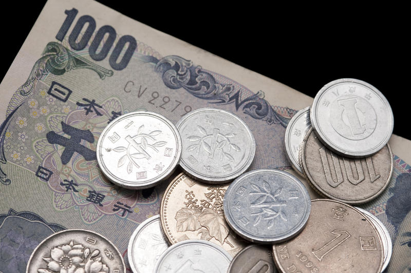 Close up financial and banking background of 1000 Japanese yen banknotes and assorted coins