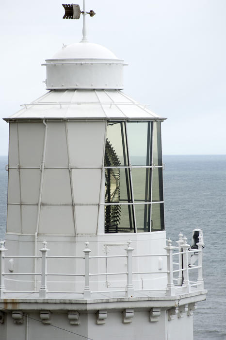 Lantern room with its lamp visible on a lighthouse overlooking the ocean at the Whitby South Lighthouse