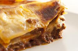 10616   Close up Edge of Tasty Italian Lasagne Dish