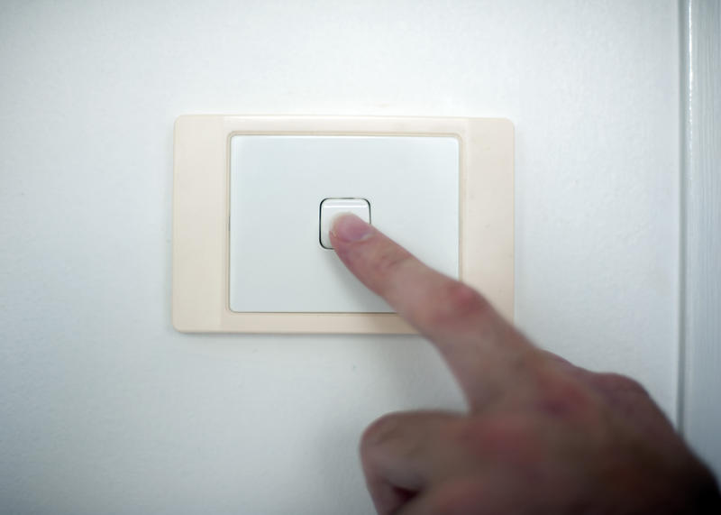 10652   Finger switching on or off a light switch