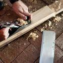 10169   Carpenter using smoothing plane