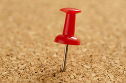 10814   Red Sharp Marker Pin Pinned on a Cork Board