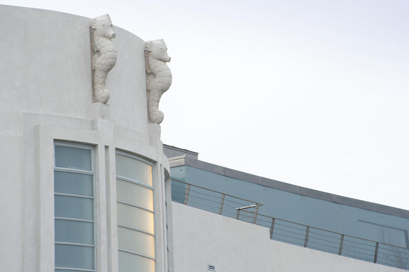 Art Deco details on the curved front facade of the Midland Hotel on the Promenade in Morecambe in the form of two white seahorses