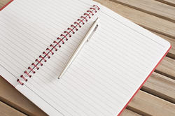 10819   Open Blank Notebook with Ballpoint Pen on Top