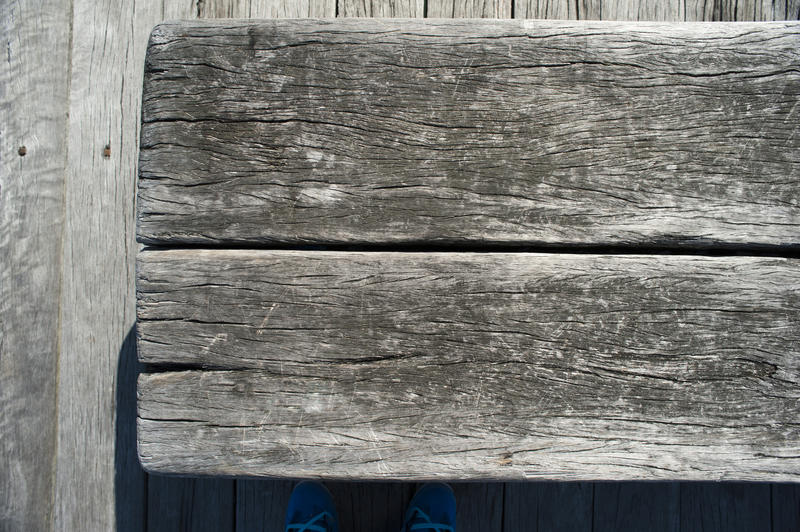 Close Up of Grey Weathered Wood Boards as Part of Old Structure Such as a Fence or Barn