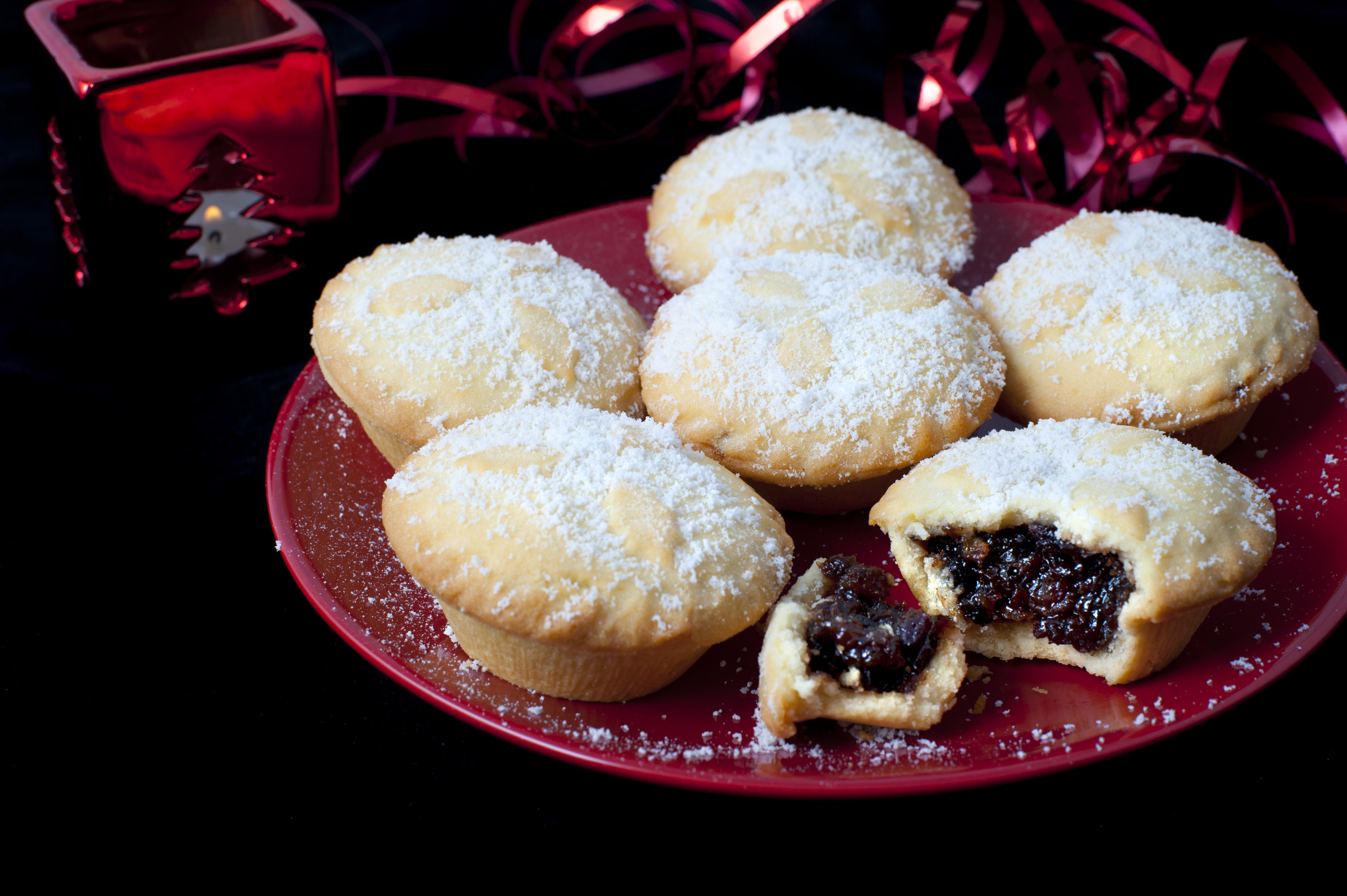 Plate of freshly baked Christmas mince pies with one broken open to display the rich fruity & Free Stock Photo 8664 Plate of freshly baked Christmas mince pies ...