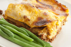 10622   Tasty Lasagna on Plate with Green String Beans