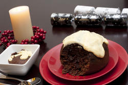 8645   Serving of Christmas pudding and brandy custard