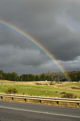 10941   Colorful rainbow in a country field