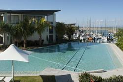 10696   Swimming pool and umbrellas at a resort