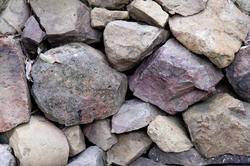 10932   Rocks in a dry stone embankment or wall