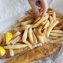 8517   Man eating a fish and chips takeaway meal
