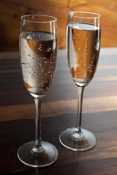 Two flutes of sparkling white wine or bubbly champagne for a romantic celebration, wedding or anniversary to drink the toasts