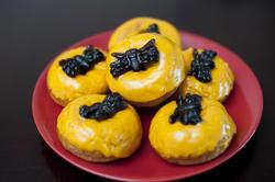 8548   Plate of colourful orange spider doughnuts