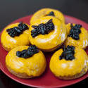 8548   Plate of colourful orange spider doughnuts