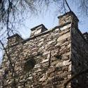 8719   External facade of a stone folly