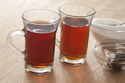 11642   Two mugs of hot sweet black tea