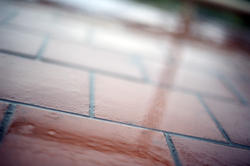 10934   Reflections in Wet Brick Tiles in Rainy Weather
