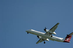 10700   Commercial Qantas airplane flying overhead