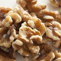 11813   Close Up of Shelled Walnuts on White Background